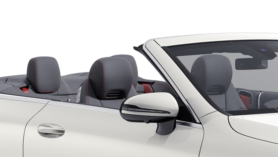 Front sport seats with integrated head restraints