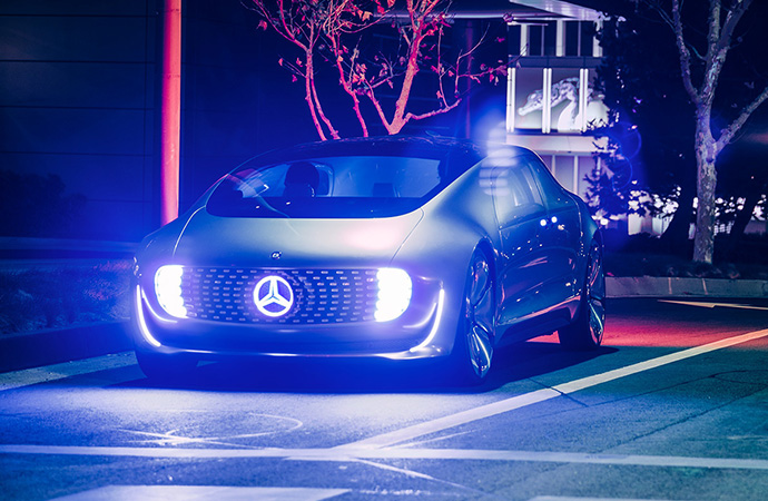 The autonomous Luxury in Motion lights up the night with its impressive exterior.